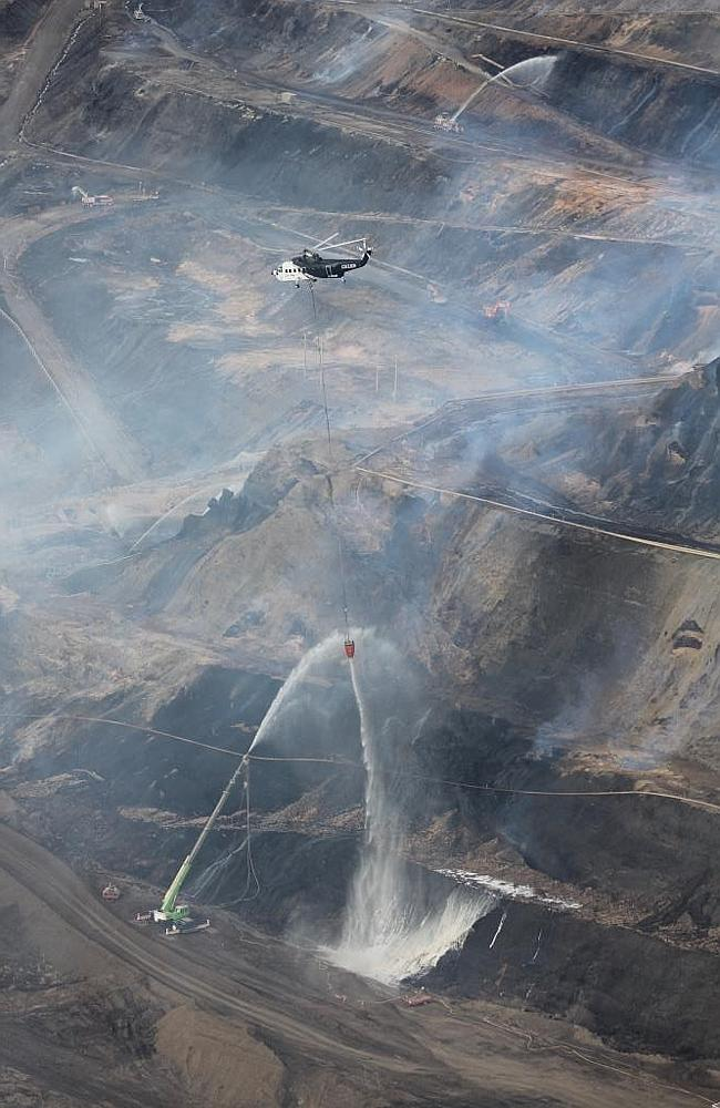 A helicopter battles the fire at the Hazelwood mine. Picture: Wayne Rigg/CFA