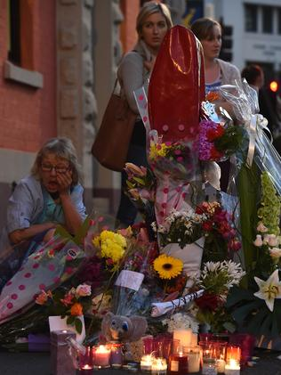 Mourners leave flowers at the candlelight vigil. Picture: Jay Town