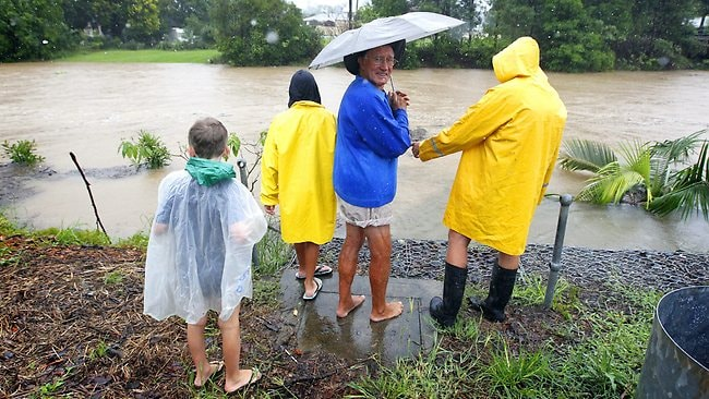 Bill Lulham watches Coffs Creek on the rise in Coffs Harbour. Picture: Bradley Hunter