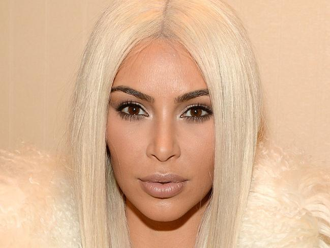 Kim's peroxide wig steals Kanye's show