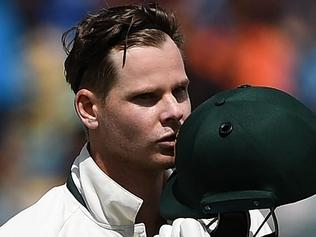 Australia's captain Steve Smith kisses his helmet as he celebrates after scoring a century (100 runs) during the fourth and last Test cricket match between India and Australia at The Himachal Pradesh Cricket Association Stadium in Dharamsala on March 25, 2017. ----IMAGE RESTRICTED TO EDITORIAL USE - STRICTLY NO COMMERCIAL USE----- / GETTYOUT---- / AFP PHOTO / PRAKASH SINGH / ----IMAGE RESTRICTED TO EDITORIAL USE - STRICTLY NO COMMERCIAL USE----- / GETTYOUT