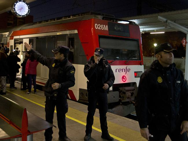 Police officers stand by a train that hit the buffers in Alcala de Henares, central Spain. Picture: AP