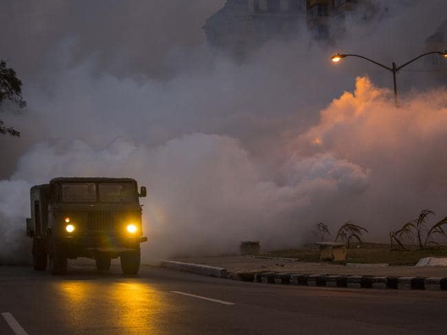 An army truck fumigates to kill mosquitos in the Vedado neighbourhood of Havana, Cuba. Picture: AP