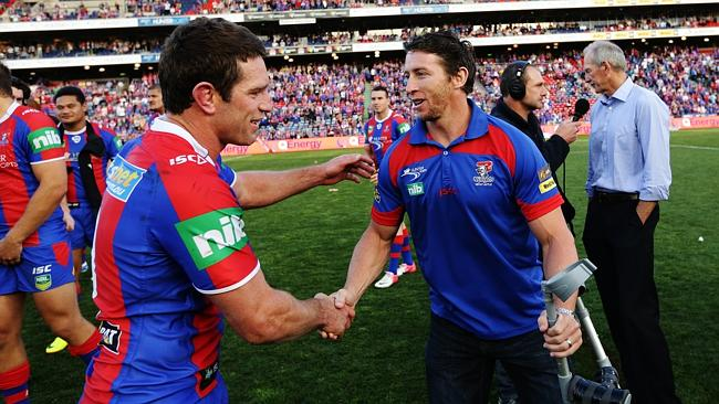 An injured Kurt Gidley congratulates Danny Buderus after playing his last game in Newcastle in the round 26 clash between the Newcastle Knights and Parramatta Eels at Hunter Stadium.