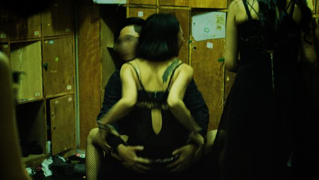 China has a ban on strip clubs and sex work but underground clubs exist where sordid acts take place. Picture: Sergey Melnitchenko