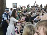 The Duchess of Cambridge greets the crowd at Manly Beach