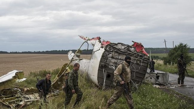 Pro-Russian fighters at the crash site of a Malaysia Airlines passenger jet. Picture: AP
