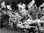 Ecstatic South Adelaide supporters armed with streamers dash on to Adelaide Oval as the Panthers win the grand final against Port Adelaide, October 3, 1964. Back when you were allowed on the field.