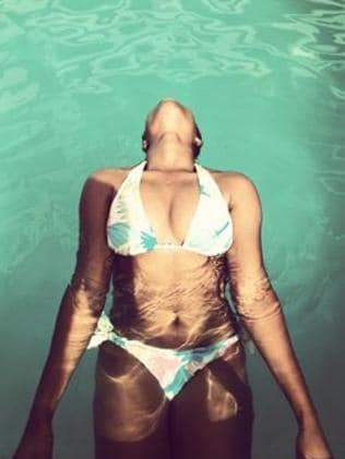 Clearly likes to titillate ... Nigerian pop singer Adokiye in a pool. Picture: Adokiye / Facebook