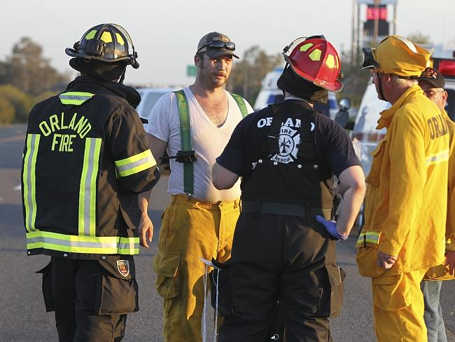 At the scene ... rescue workers, police and firefighters work the collision site.