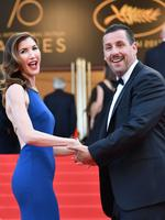 US actor Adam Sandler and his wife Jackie Titone pose as they arrive on May 21, 2017 for the screening of the film 'The Meyerowitz Stories (New and Selected)' at the 70th edition of the Cannes Film Festival in Cannes, southern France. Picture: AFP