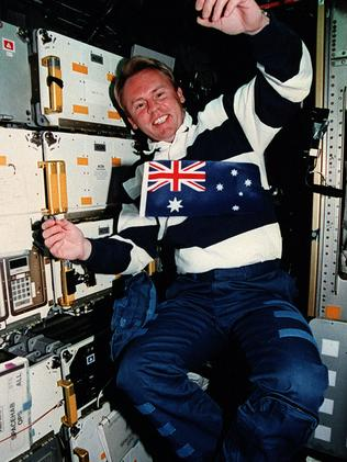 SA-born astronaut Dr Andy Thomas in a space shuttle showing the Australian flag.