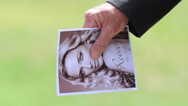 """A relative of late South African model Reeva Steenkamp holds the funeral program upon arriving at the crematorium building in Port Elizabeth on February 19, 2013. The 29-year-old law graduate and cover girl was gunned down four times on February 14, 2013 at the upmarket Pretoria home of the Olympic and Paralympic star Oscar Pistorius. South African prosecutors on February 19 told a bail hearing that Oscar Pistorius was guilty of """"premeditated murder"""" in the Valentine's Day killing of his model girlfriend at his upscale home. AFP PHOTO / ALEXANDER JOE"""