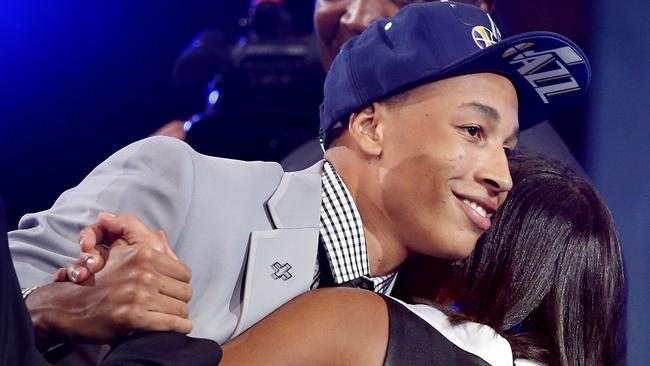 Dante Exum hugs friends and family after being selected by the Utah Jazz.