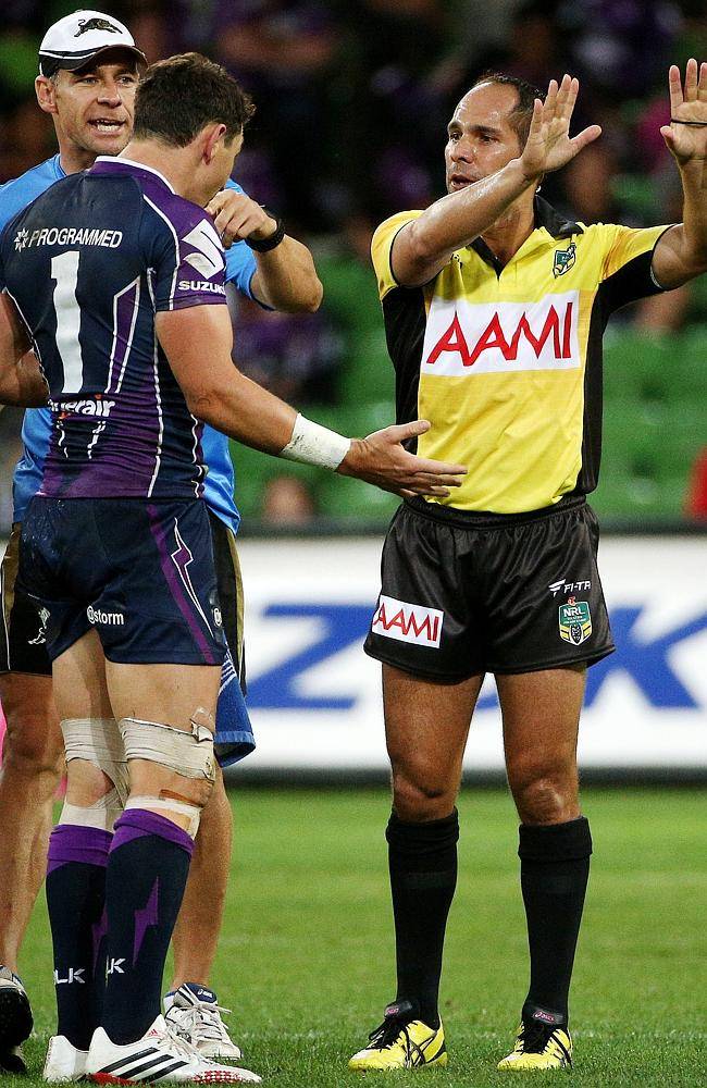 Billy Slater argues his case with referee Ashley Klein.