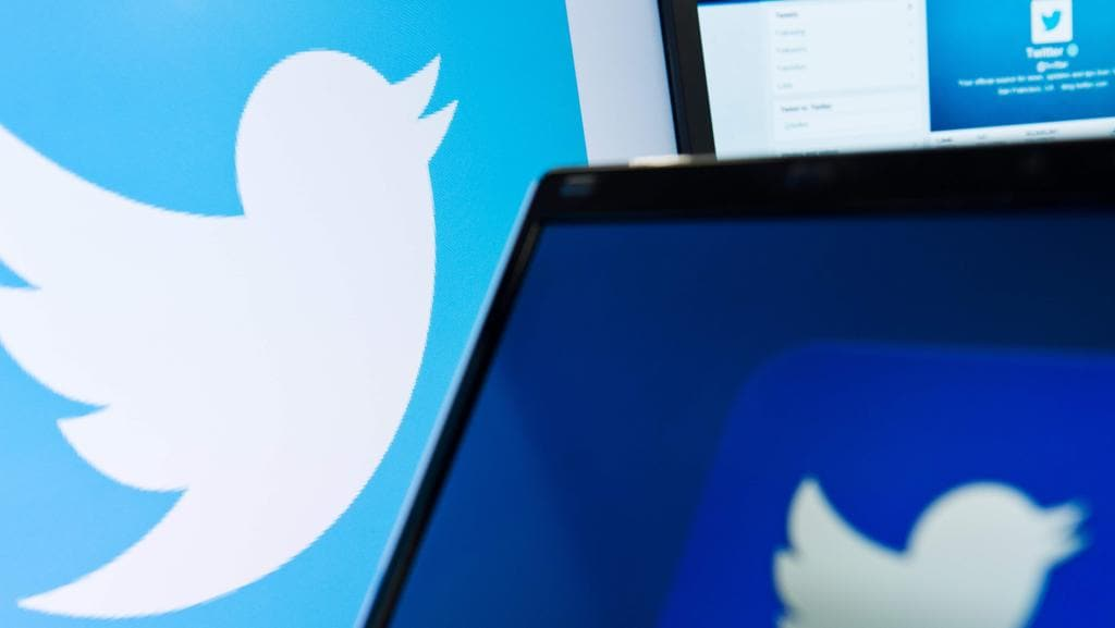 Hackers have gone through a third-party app to take over thousands of Twitter accounts overnight. Picture: AFP/Leon Neal