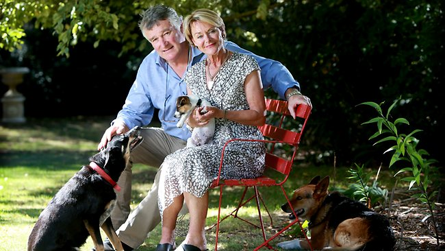 Shane and Catherine McCarthy, parents of former Collingwood and Port Adelaide player John, with their dogs Olle, Poppy and Jules at their home in Portsea, Victoria. Picture: Calum Robertson
