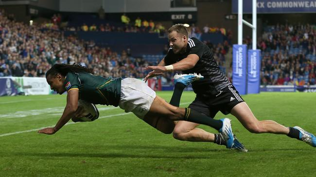 Cecil Afrika dives over to score a try for South Africa against New Zealand in the final.