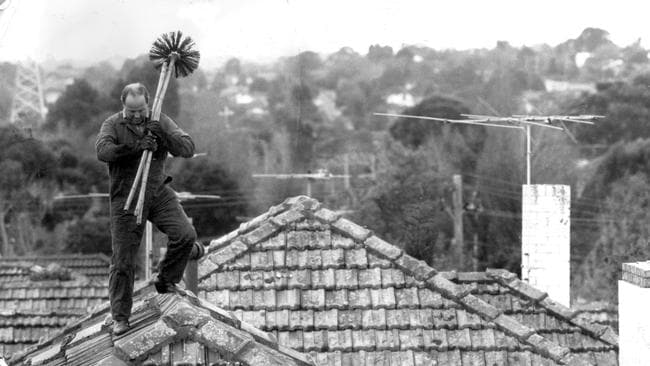 Chimney sweep Kenneth Innes at work in 1988. Picture: Herald Sun Image Library