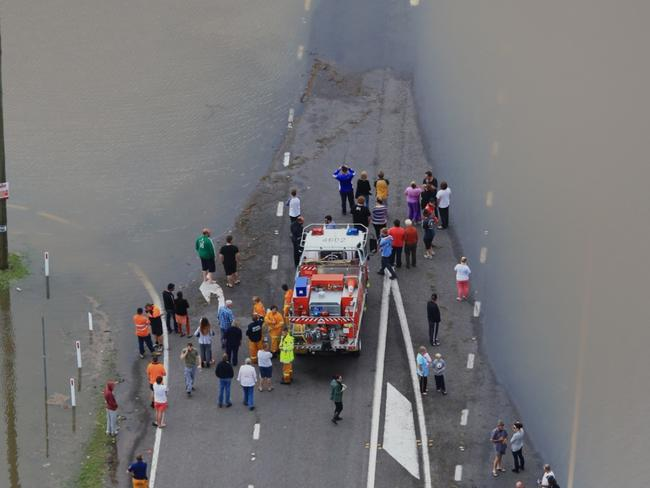 NSW SES workers searching for two people swept from the causeway on Cessnock Road, Maitland today. Picture: Adam Taylor