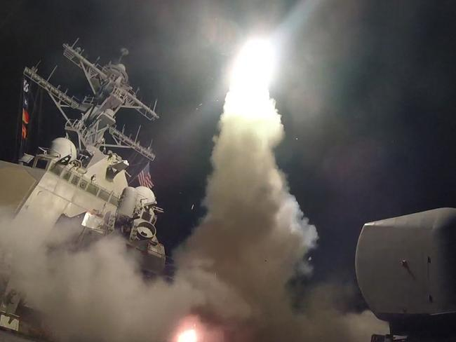 The guided-missile destroyer USS Porter fires a Tomahawk missile at Syria. Picture: US Navy/Getty