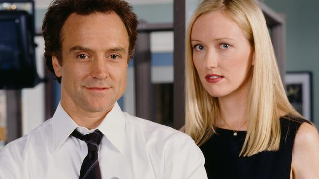 Bradley Whitford as Josh Lyman and Janel Maloney as Donna Moss.