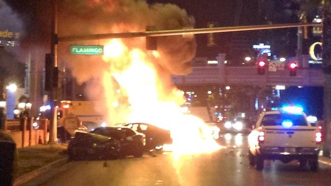 Smoke and flames billow from a burning vehicle following a shooting and multi-car accident on the Las Vegas Strip. Picture: Erik Lackey
