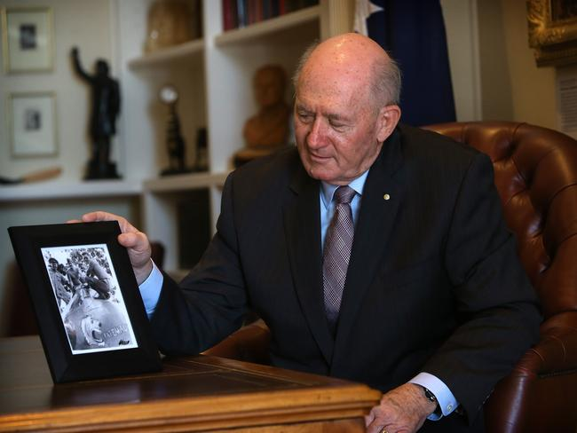 Governor-general Sir Peter Cosgrove with a photo of his uncle Bill Cosgrove, a wartime RAAF pilot.