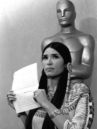 Littlefeather holds the statement written by Marlon Brando explaining why he refused his Oscar.
