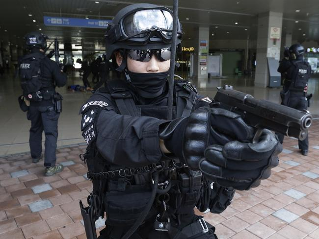 A South Korean police officer aims his gun during an anti-terror drill as part of Ulchi Freedom Guardian exercise, in Goyang, South Korea. Picture; AP Photo/Ahn Young-joon.