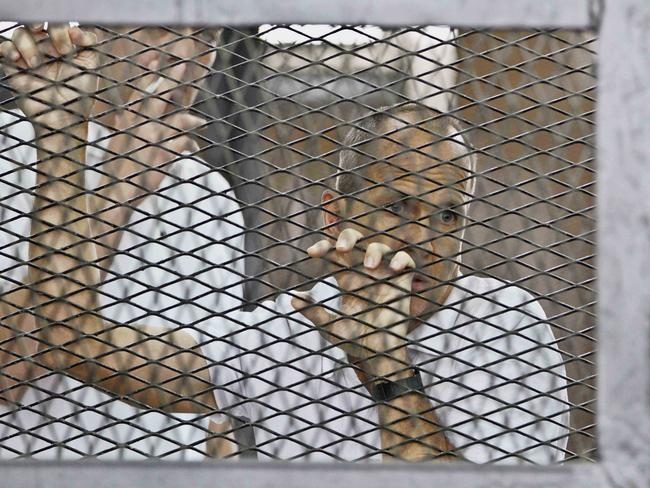 Jailed...Australian Al-Jazeera journalist Peter Greste in court during his trial in Cairo in May. Picture: AFP