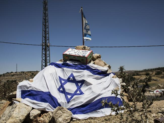 A makeshift memorial site is constructed in memory of the three Israeli teenagers found dead. Photo: Ilia Yefimovich/Getty Images