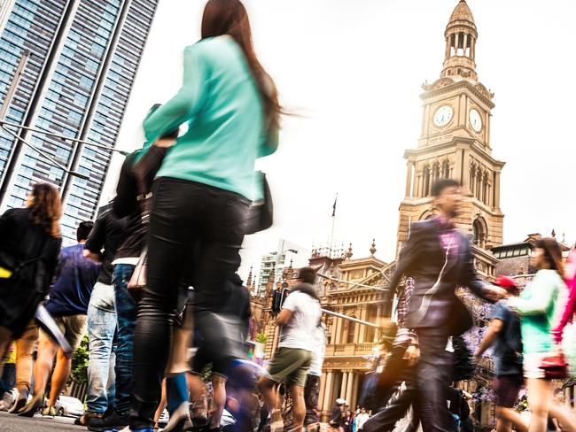 Sydney downtown, blurred intersection people and traffic in a sunny day at dusk. Picture: istock