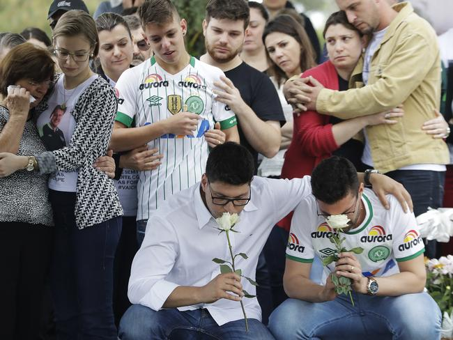 Relatives attend the burial of Chapecoense soccer team's late president Sandro Pallaoro. Picture: Andre Penner/AP