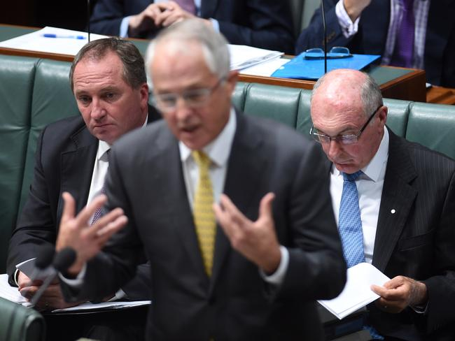 Nationals Barnaby Hoyce and Warren Truss listen, ahem, intently to Malcolm Turnbull's Mal-splaining in Question Time yesterday. Picture: AAP Image/Lukas Coch