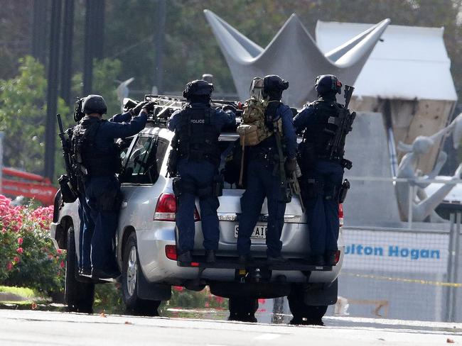 TERROR: Star Group officers leaving Thursday's siege scene. Picture: Sarah Reed.