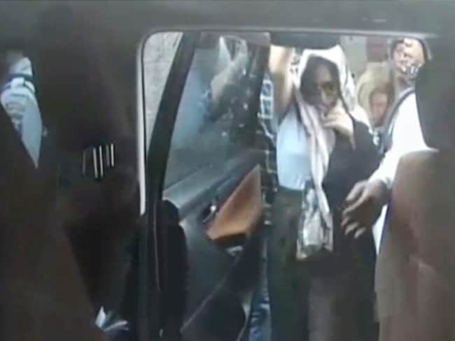 Schapelle Corby getting into the van to got the the parole office. Picture: Channel Nine