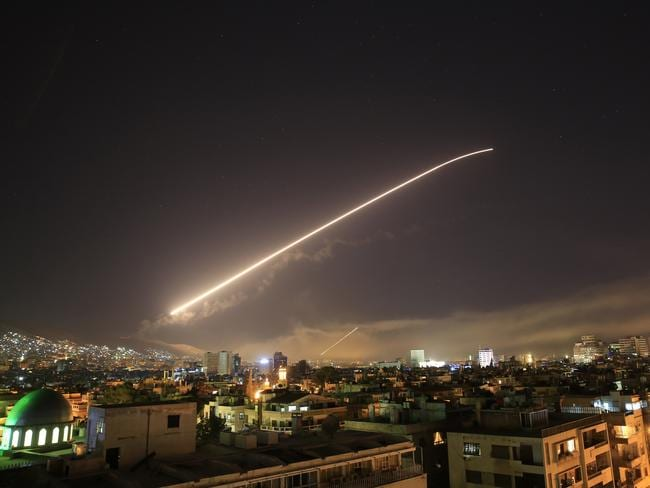 Damascus sky lights up with surface to air missile fire as the US launches an attack on Syria targeting different parts of the Syrian capital Damascus, Syria. Picture: AP