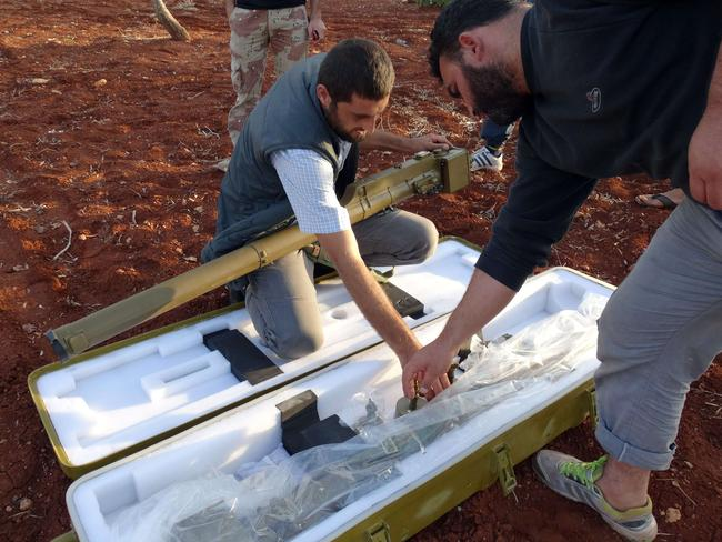 Worrying...Rebel fighters unpack a Chinese made manportable surface-to-air missile north of Aleppo. Picture: AFP.