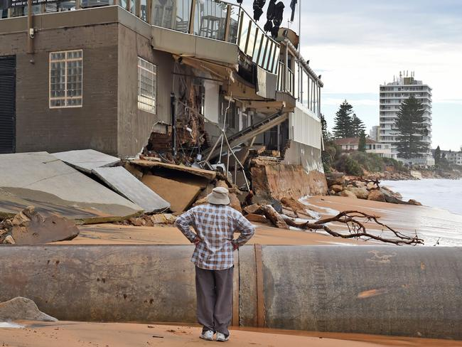 Inspecting the damage at Collaroy on Sydney's northern beaches. Picture: William West/AFP