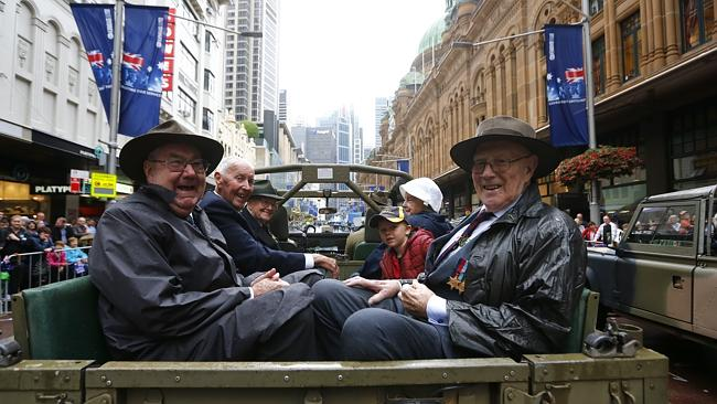 Rain failed to dampen spirits along George St. Picture: Bradley Hunter