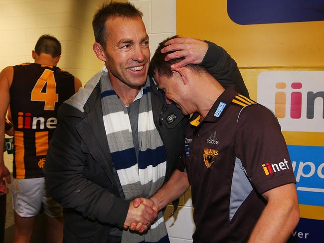 Alastair Clarkson hugs stand-in coach Brendon Bolton after their win during the round 13 win over Carlton. Photo by Michael Dodge