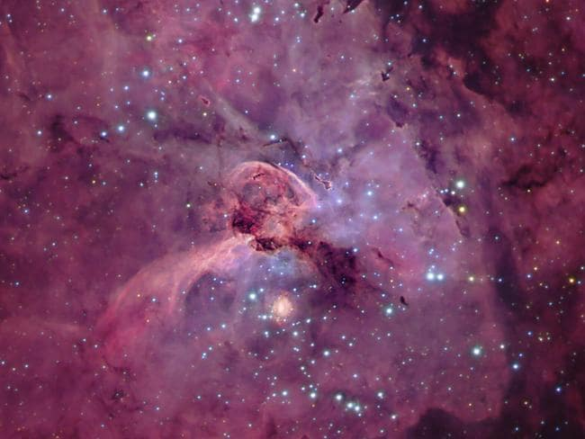 Cosmic cauldron ... The Carina Nebula is a chaotic region of star formation several thousand light years from Earth. In the central part of the nebula, shown here, dense clouds of gas and dust are lit up by the light of newly born stars. One of these is a true giant — the star Eta Carinae right at the centre of this image. Source: 2013 Astronomy Photographer of the Year: Michael Sidonio