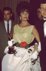 Taking out the statue for her role in Butterfield 8, screen goddess Elizabeth Taylor is still credited with one of the all-time most stylish Oscars looks with a white floral gown teamed with yellow top and adorned with a rose at her waist. Picture: Getty