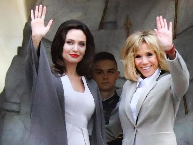 Not your average day. Jolie poses next to the French First Lady Brigitte Macron. Picture: Instar Images
