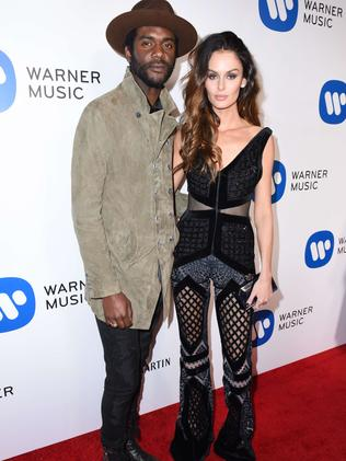 "Aussie model Nicole Trunfio, with Gary Clark Jr, said the fires were ""too close"". Picture: Vivien Killilea/Getty Images/AFP"