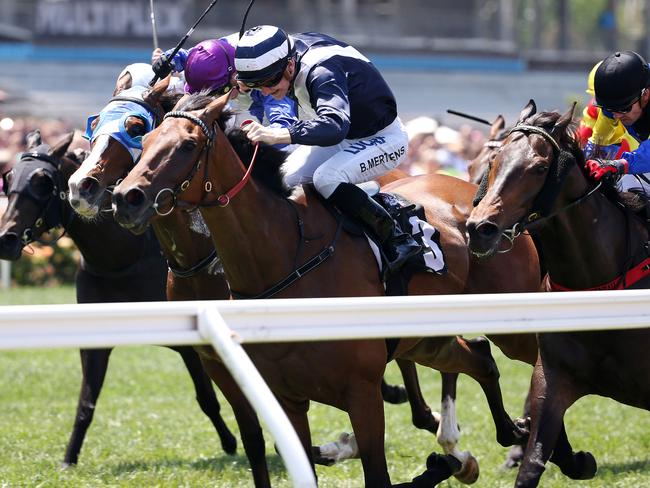 Oncidium Ruler, ridden by Beau Mertens, storms home to win on Emirates Stakes Day. Picture: Michael Klein