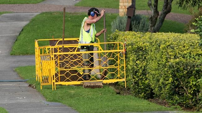 Workers installing the National Broadband Network (NBN) in Kiama Downs. It has been identified as a shining example of wasted taxpayer dollars.