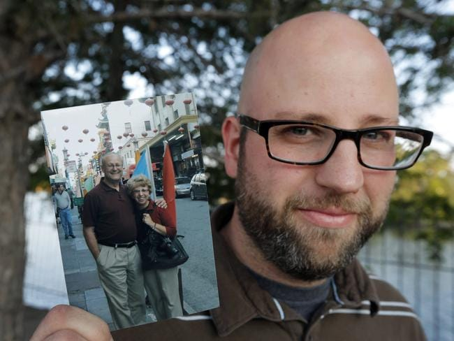 Fighting ... Jeremy Writebol holds a photograph of his mother Nancy Writebol, an American missionary stricken with Ebola. Picture: AFP