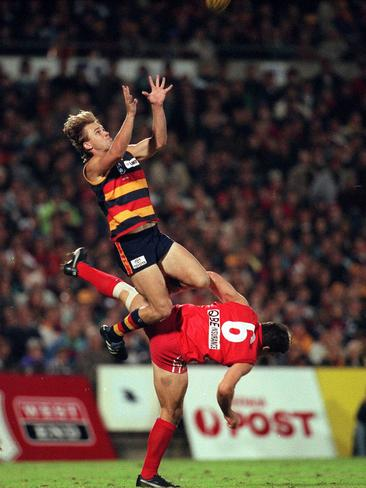 Modra takes a screamer over Andrew Dunkley at Football Park.